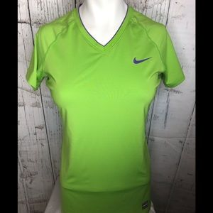 Nike green t shirt with purple trim size m…